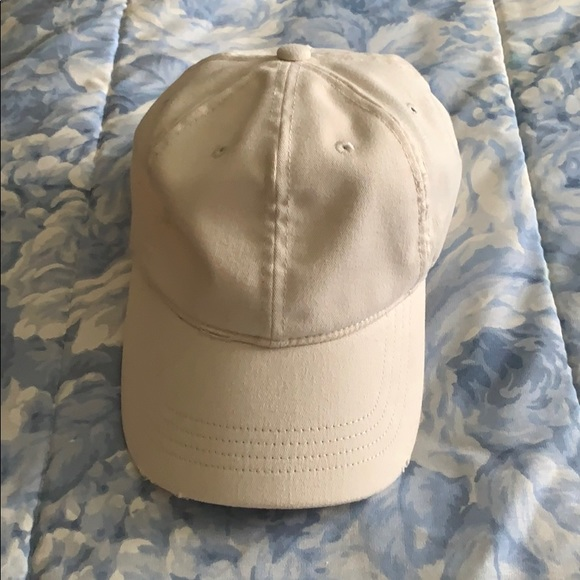 Off white colored destroyed hat
